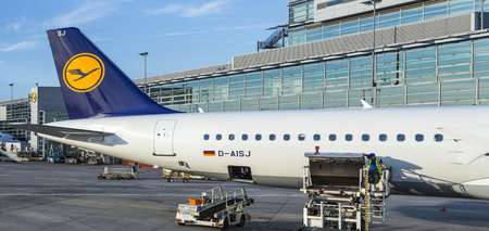 FRANKFURT, GERMANY - JUNE 13, 2014: Lufthansa Aircrafts standing at the terminal 1 at Frankfurt airport. Frankfurt is one of the busiest airport in Europe and Number one in Germany.
