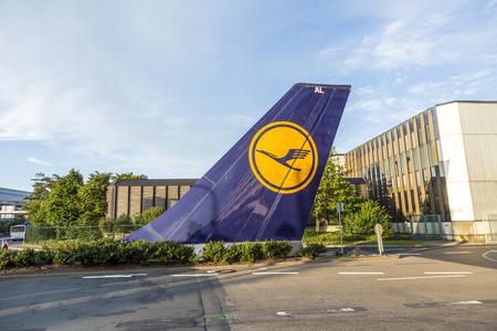 headquarter: FRANKFURT, GERMANY - AUG 22, 2014: vertical tail sign installed at Tor 21 at Lufthansa headquarter  in Frankfurt, Germany.