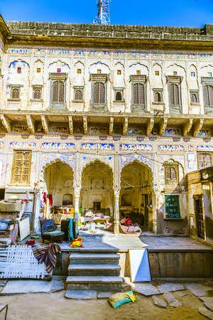 frescoed: MANDAWA, INDIA, OCT 25, 2012: people life in old haveli in  Mandawa, India. The town referres as open art gallery of Rajasthan because of its fascinating havelis with lavishly painted walls.