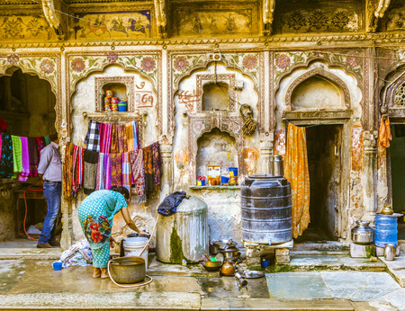 MANDAWA, INDIA, OCT 25, 2012: people life in old haveli in  Mandawa, India.  The town referres as open art gallery of Rajasthan because of its fascinating havelis with lavishly painted walls.