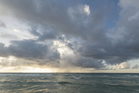 View of storm seascape in sunset