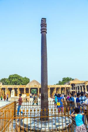 monument in india: DELHI, INDIA - MARCH 27, 2012: Unidentified tourists walk around Qutub Minar complex in Delhi, India. Qutub Minar is the tallest minar in India, originally an ancient Islamic Monument.