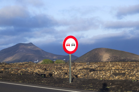 overtake: Landscape with a traffic sign: Dont overtake
