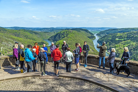 saar: CLOEF, GERMANY - APRIL 29, 2013: people enjoy the spectacular view  to Saar loop at Cloef, Germany. The scenic spot was built in 1856 and is the most famous saar view spot in the Saarland. Editorial