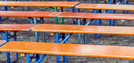 hinged: hinged benches made of wood at the floor Stock Photo