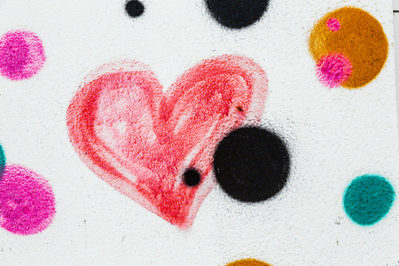 Red painted heart on a concrete wall photo