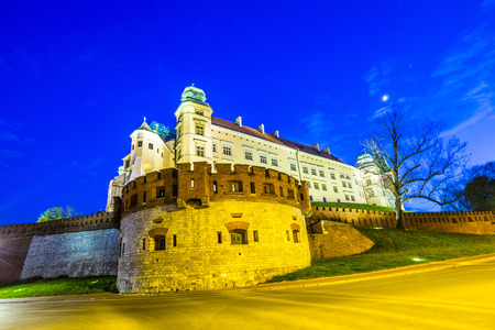 polska: illuminated Wawel Hill by night in Cracow, Poland
