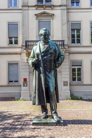 radium: HEIDELBERG, GERMANY - JULY 7, 2013: statue of Robert Wilhelm Bunsen in Heidelberg, Germany. In 1852 Bunsen became professor for chemics at the  Ruprecht-Karl university in Heidelberg.