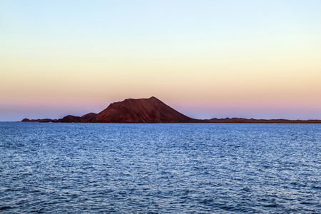 sunset in Fuerteventura, Canary islands seen from the ocean Stock Photo - 29818992
