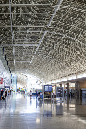 EL MATORRAL, SPAIN - MARCH 28, 2013: arrival hall at  Airport of Fuenteventurain El Matorral, Spain. The airport was opened officially on 14 September 1969 and has the capability to handle 5 Mio passengers per year. Publikacyjne