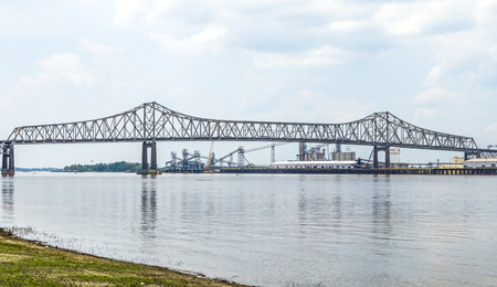 horace: BATON ROUGE - JULY 13, 2013: Mississippi River Bridge in Baton Rouge, USA. The Horace Wilkinson Bridge is a cantilever bridge carrying Interstate 10 in Louisiana across the Mississippi River. It is the highest bridge on the Missisippi River.