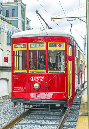 streetcar: NEW ORLEANS, USA - JULY 15, 2013: One of the many streetcars serving Riverfront streetcar in New Orleans, USA.  It is the oldest continually operating street car line in the world.