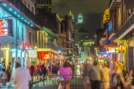 NEW ORLEANS, USA - JULY 14, 2013: Neon lights in the French Quarter in New Orleans, USA. Tourism provides a much needed source of revenue after the 2005 devastation of Hurricane Katrina. 報道画像