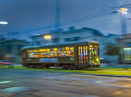 NEW ORLEANS, USA - JULY 15, 2013:  Streetcar Line in New Orleans, USA. Newly revamped after Hurricane Katrina in 2005, the New Orleans Streetcar line began electric operation in 1893.