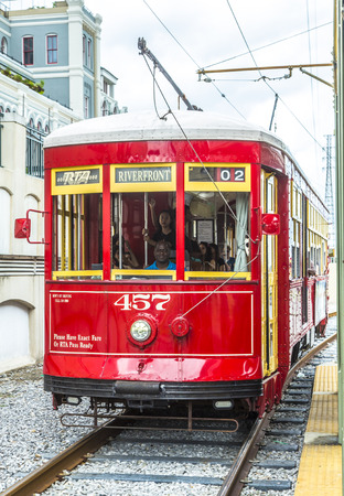 streetcar: NEW ORLEANS, USA - JULY 15, 2013  One of the many streetcars serving Riverfront streetcar in New Orleans, USA   It is the oldest continually operating street car line in the world  Editorial