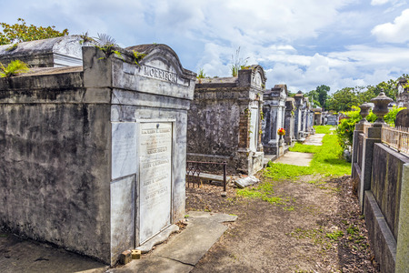 lafayette: NEW ORLEANS, USA - JULY 16, 2013: Lafayette cemetery with historic Grave Stones in New Orleans, USA. Built in what was once the City of Lafayette, the cemetery was officially established in 1833.