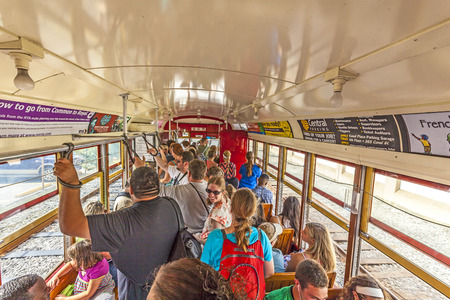 streetcar: NEW ORLEANS, USA - JULY 16, 2013: people ride in the riverfront  Streetcar Line in New Orleans, USA. Revamped after Hurricane Katrina in 2005, the New Orleans Streetcar line began electric operation in 1893. Editorial