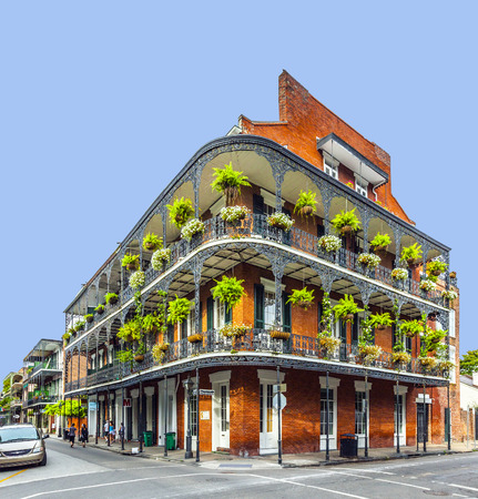 NEW ORLEANS, LOUISIANA USA - JULY 16, 2013: people visit historic building in the French Quarter  in New Orleans, USA. Tourism provides a large source of revenue after the 2005 devastation of Hurricane Katrina.