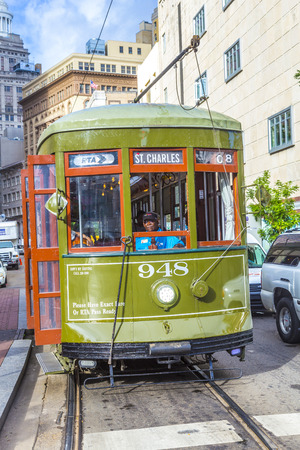 st charles: NEW ORLEANS, USA - JULY 17, 2013:   Streetcar Line St. Charles in new Orleans, USA. Newly revamped after Hurricane Katrina in 2005, the New Orleans Streetcar line began electric operation in 1893. Editorial