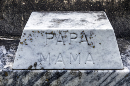 Lafayette cemetery in New Orleans with historic Grave Stones and inscription Papa and Mama, Dad and Mom photo