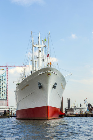 sued: HAMBURG, GERMANY -JULY 17, 2014: MS Cap San Diego is a general cargo ship, situated as a museum ship in Hamburg, Germany. The Cap San Diego was built and launched by Deutsche Werft in 1961 for Hamburg Sued as the last of a series of six ships