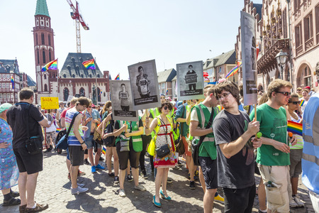 roemer: FRANKFURT, GERMANY - JULY 19, 2014: Christopher Street Day in Frankfurt, Germany. Crowd of people Participate in the parade celebrates gays, lesbians and bisexuals. Prominent in the image a elaborately dressed participants.