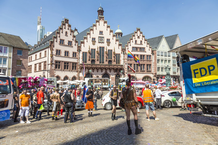 bisexuals: FRANKFURT, GERMANY - JULY 19, 2014: Christopher Street Day in Frankfurt, Germany. Crowd of people Participate in the parade celebrates gays, lesbians and bisexuals. Prominent in the image a elaborately dressed participants.