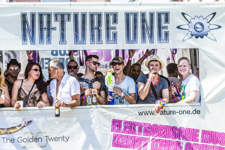 bisexuals: FRANKFURT, GERMANY - JULY 19, 2014: Christopher Street Day in Frankfurt, Germany. Crowd of people Participate in the parade celebrates gays, lesbians and bisexuals. Participants enjoy the parade on a waggon. Editorial