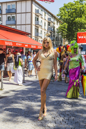 FRANKFURT, GERMANY - JULY 19, 2014: Christopher Street Day in Frankfurt, Germany. Crowd of people, gays, lesbian and bisexuals, participate in the parade celebrating the Christopher street day. Éditoriale