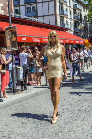 bisexuals: FRANKFURT, GERMANY - JULY 19, 2014: Christopher Street Day in Frankfurt, Germany. Crowd of people, gays, lesbian and bisexuals, participate in the parade celebrating the Christopher street day. Editorial