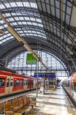 frequented: FRANKFURT, GERMANY - JULY 19, 2014: people Inside the Frankfurt central station in Frankfurt, Germany. With about 350.000 passengers per day its the most frequented railway station in Germany.