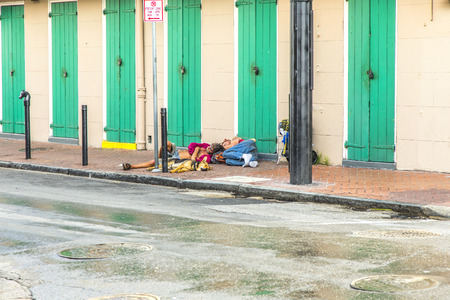 obama care: NEW ORLEANS, LOUISIANA USA - JULY 17, 2013: people sleep at the street in the French Quarter in New Orleans, USA. The U.S. Department of Housing and Urban Development in January 2012 annual point-in-time count found that 633,782 people across America were