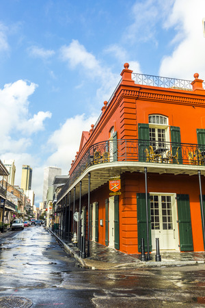 bourbon street: NEW ORLEANS, LOUISIANA USA - JULY 17, 2013: people visit historic building in the French Quarter in New Orleans, USA. Tourism provides a large source of revenue after the 2005 devastation of Hurricane Katrina. Editorial