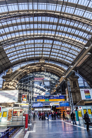 frequented: FRANKFURT, GERMANY - MARCH 2, 2013: people inside the Frankfurt central station  in Frankfurt, Germany. With about 350.000 passengers per day its the most frequented railway station in Germany.