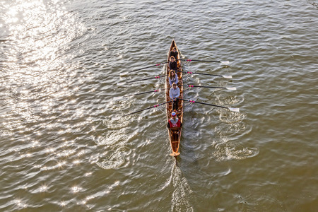 FRANKFURT, GERMANY - MARCH 2, 2013: A  boat team trains at river main in Frankfurt, Germany. They traqin for the Ruderverein Frankfurt, an old sports club from 1869 which has a famous boatshouse in Sachsenhausen at river Main.