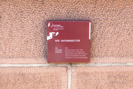 constantin: FRANKFURT, GERMANY - MARCH 2, 2013:   plate of statue der Hafenarbeiter at the bridge in Frankfurt, Germany. The statue was a gift of the company Cassella and build by artist Constantin Meunier in 1899. Editorial