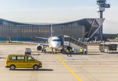 FRANKFURT, GERMANY - June 20, 2013: Lufthansa aircraft in front of maintanance hall in Frankfurt Germany. The new runway opened in APR 2012 and causes a lot of polictical discussion because of heravy noise.