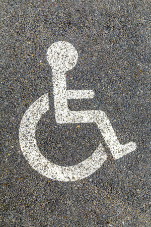 permit: Disabled parking permit sign painted on the street