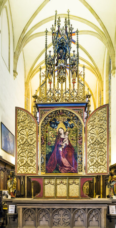 high altar: COLMAR, FRANCE - JULY 3, 2013: famous altar Madonna in a rose garden in Colmar, France. The altar was built by Martin Schongauer in 1473.