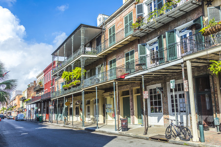 bourbon street: NEW ORLEANS, LOUISIANA USA - JULY 17, 2013: historic building in the French Quarter in New Orleans, USA. Tourism provides a large source of revenue after the 2005 devastation of Hurricane Katrina. Editorial
