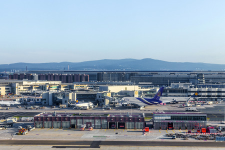 million: FRANKFURT, GERMANY - JULY 24, 2014: Terminal 1 in sunrise in Frankfurt, Germany. It is one of the busiest airport in Europe with 59 million passengers in 2011.