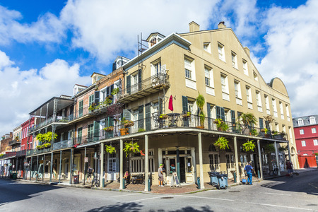 NEW ORLEANS, LOUISIANA USA - JULY 17, 2013: people visit historic building in the French Quarter in New Orleans, USA. Tourism provides a large source of revenue after the 2005 devastation of Hurricane Katrina. Editorial