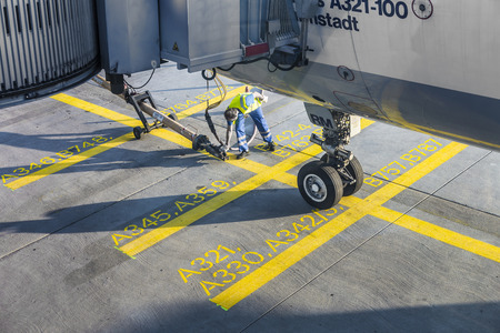 FRANKFURT, GERMANY - JULY 24: Close up of aircraft wheel at the gate in Frankfurt, Germany. The gates can be used by Boeing and Airbus aircrafts, detailed position is marked.