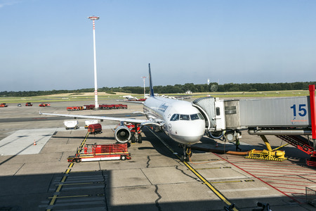 HAMBURG, GERMANY - MAY 24, 2014: Lufthansa Aircrafts at the gate in the modern Terminal 2 on Dec 15, 2011 in Hamburg, Germany. Terminal 2 was completed in 1993 and houses Lufthansa and other Star Alliance partners.