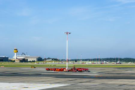 HAMBURG, GERMANY - JULY 24, 2014: communication and light mast at apron of Hamburg Airport  in Hamburg, Germany. It is the fifth-busiest German airport with 13 mio pax in 2011.