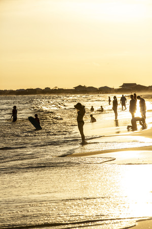trustful: DAUPHIN ISLAND, USA - JULY 17, 2013: people enjoy the beautiful beach in late afternoon  at Dauphin Island, USA.