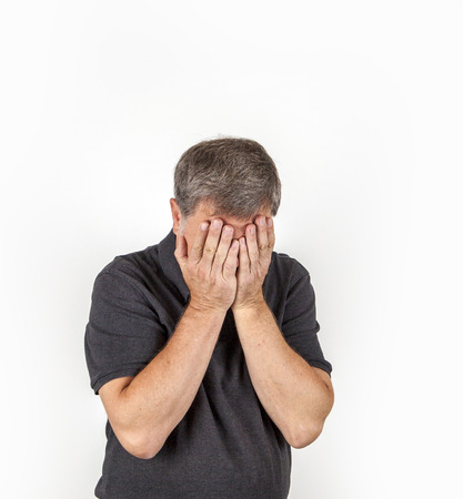 trustful: Handsome middle age man cover his face on a white background.