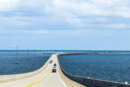 DAUPHIN ISLAND, USA - JULY 18, 2013: crossing the Dauphin Island Bridge in Dauphin Island, USA. The original bridge opened on July 2, 1955 under the name Gordon Persons bridge.