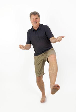 shoeless: Full Length Portrait of  Confident Barefoot Man in Blue Jeans Stock Photo