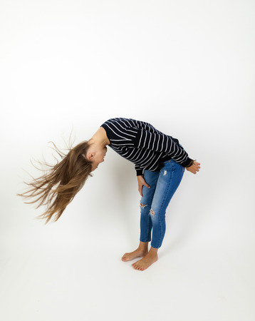 young beauty girl flying in jump with brown hair photo